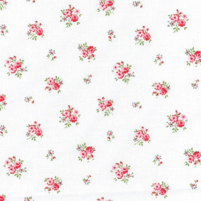 Tissu blanc avec bouquets de roses rouges